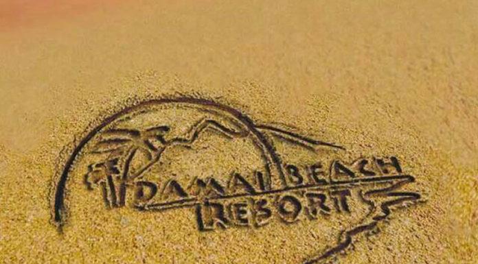 Damai Beach Resort logo in sand